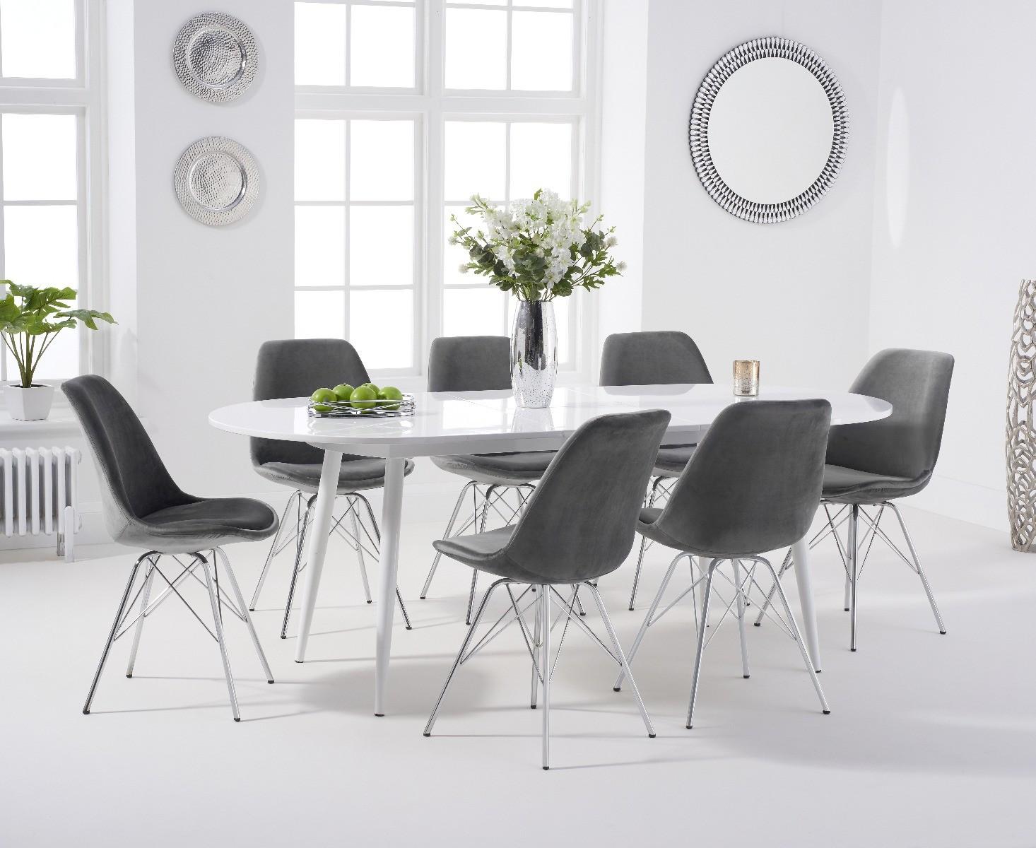 An image of Olivia Extending White High Gloss Dining Table with Celine Velvet Chrome Leg Cha...