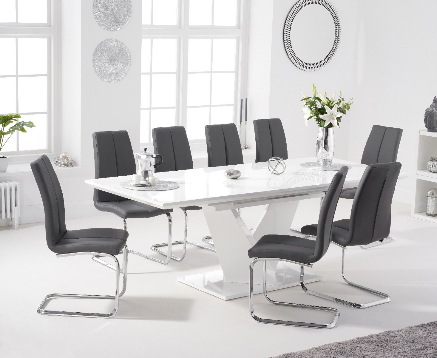 An image of Halo 160cm White High Gloss Extending Dining Table with Tarin Faux Leather Chair...