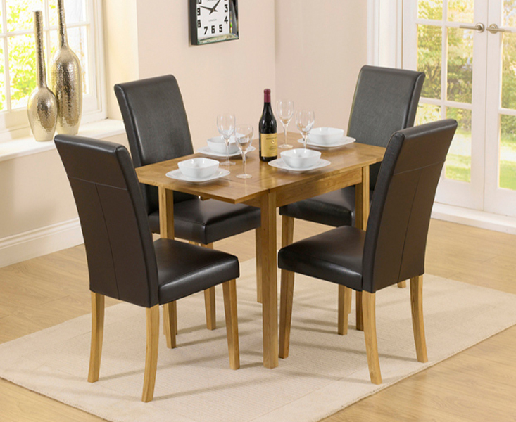 An image of Oxford 70cm Solid Oak Extending Dining Table with Albany Black Chairs - Black, 2...