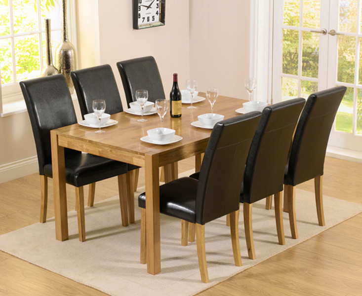 An image of Oxford 150cm Solid Oak Dining Table with Albany Black Chairs