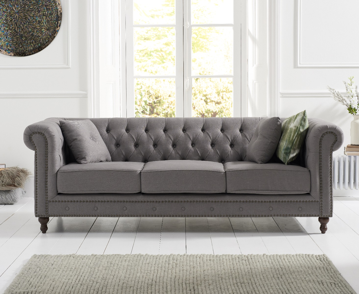Product photograph showing Milano Chesterfield Grey Linen Fabric 3 Seater Sofa