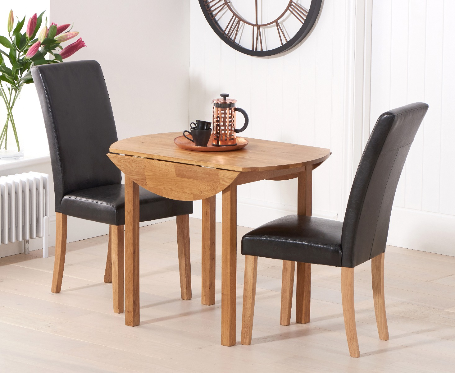 Product photograph showing Oxford 90cm Solid Oak Drop Leaf Extending Dining Table With Albany Black Chairs