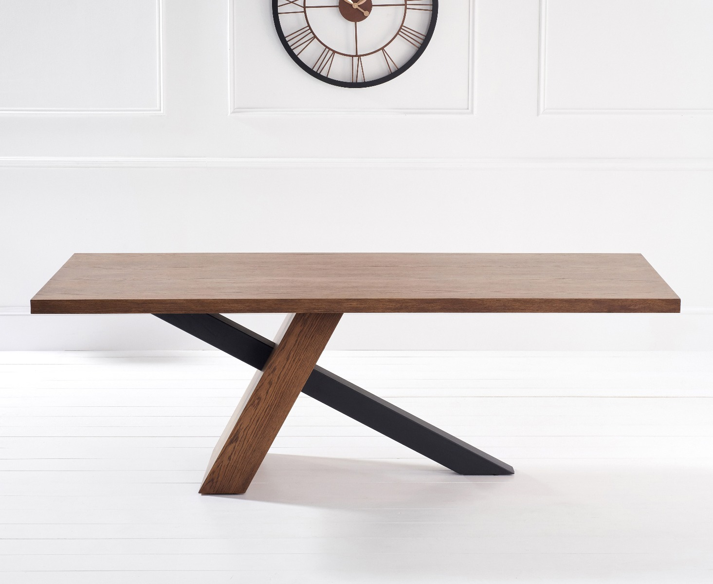 Product photograph showing Chateau 225cm Oak And Metal Black Leg Dining Table