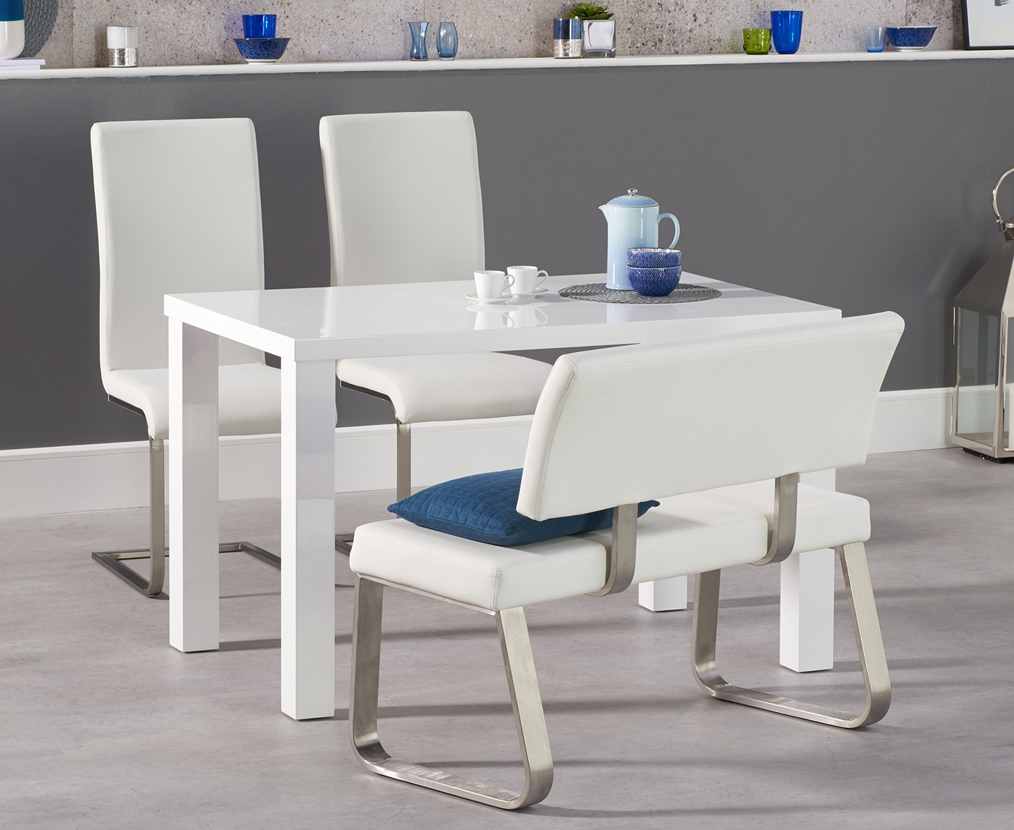 An image of Atlanta 120cm White High Gloss Dining Table with Malaga Chairs and Malaga White ...