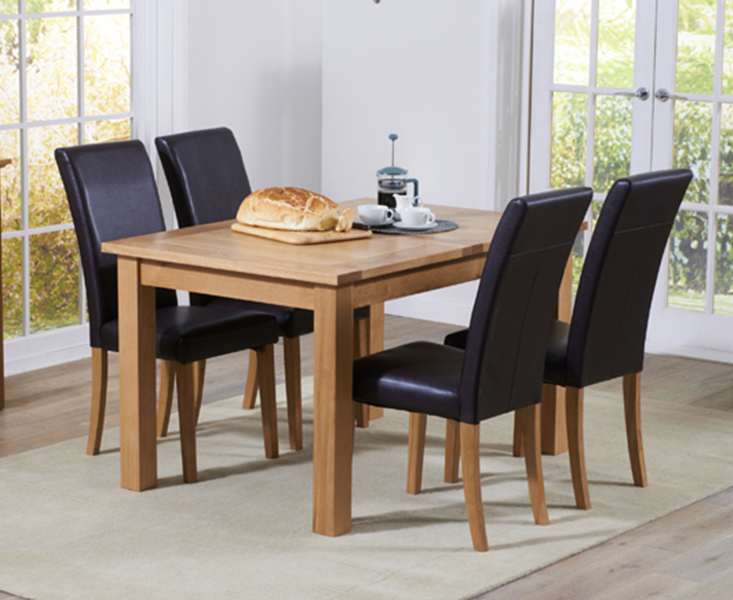 An image of Cheadle 120cm Oak Extending Dining Table with Albany Chairs