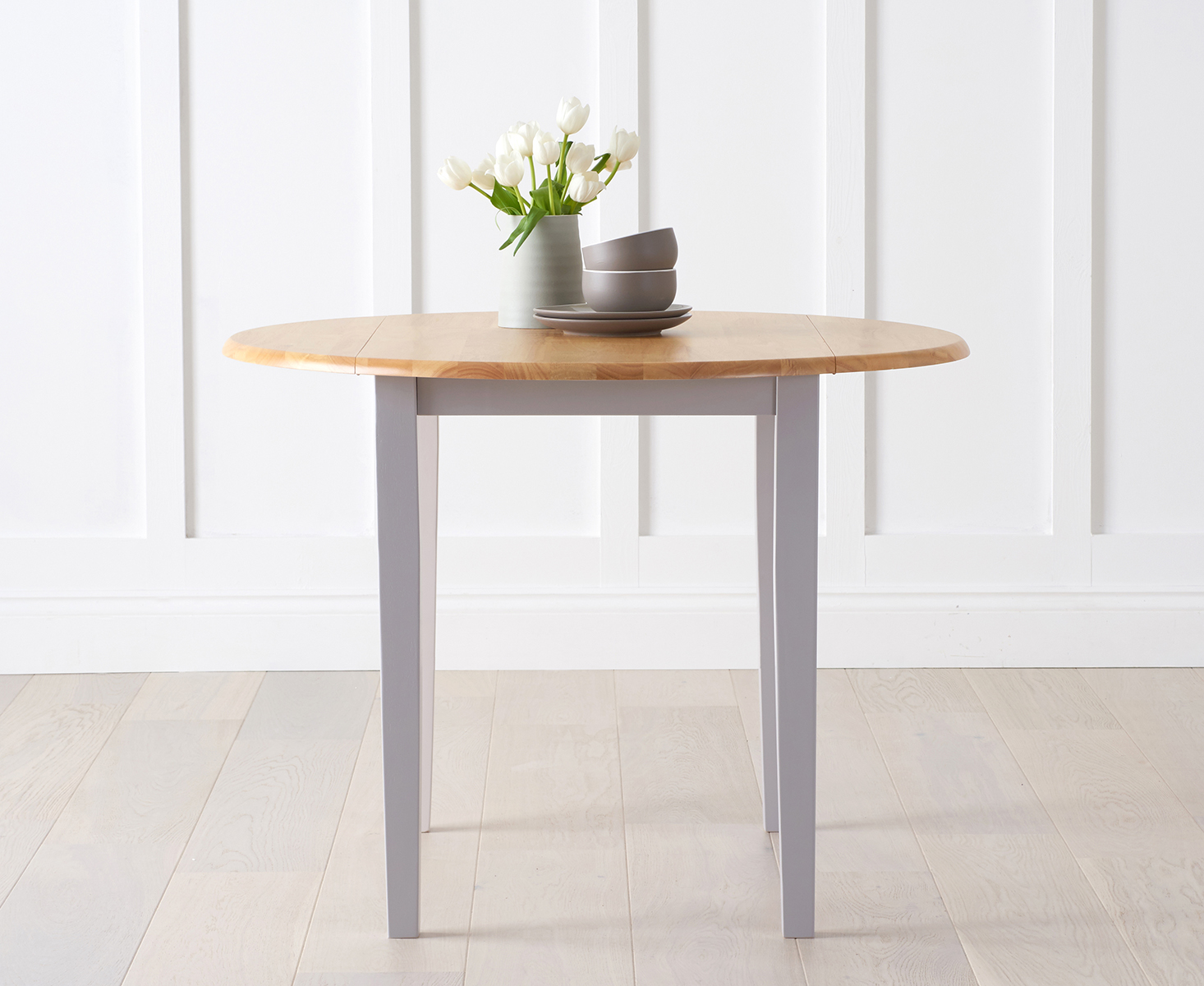 An image of Genoa Oak and Grey 100cm Drop Leaf Extending Dining Table