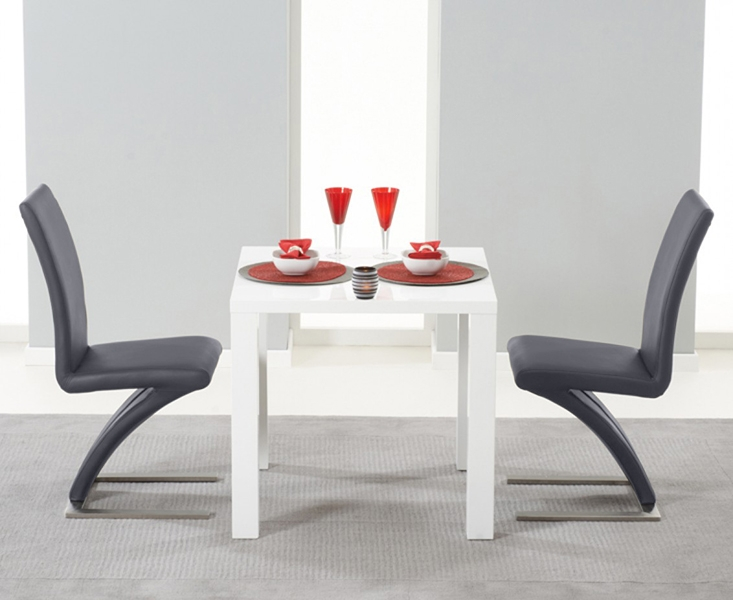 An image of Atlanta 80cm White High Gloss Dining Table with Hampstead Z Chairs