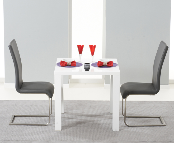 Product photograph showing Atlanta 80cm White High Gloss Dining Table With Malaga Chairs