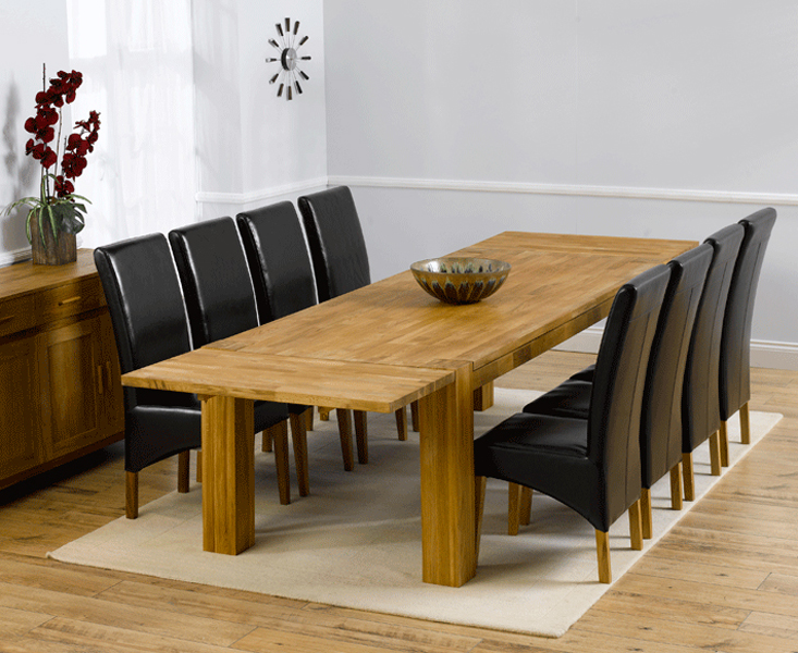 Product photograph showing Madrid 240cm Solid Oak Extending Dining Table With Cannes Chairs