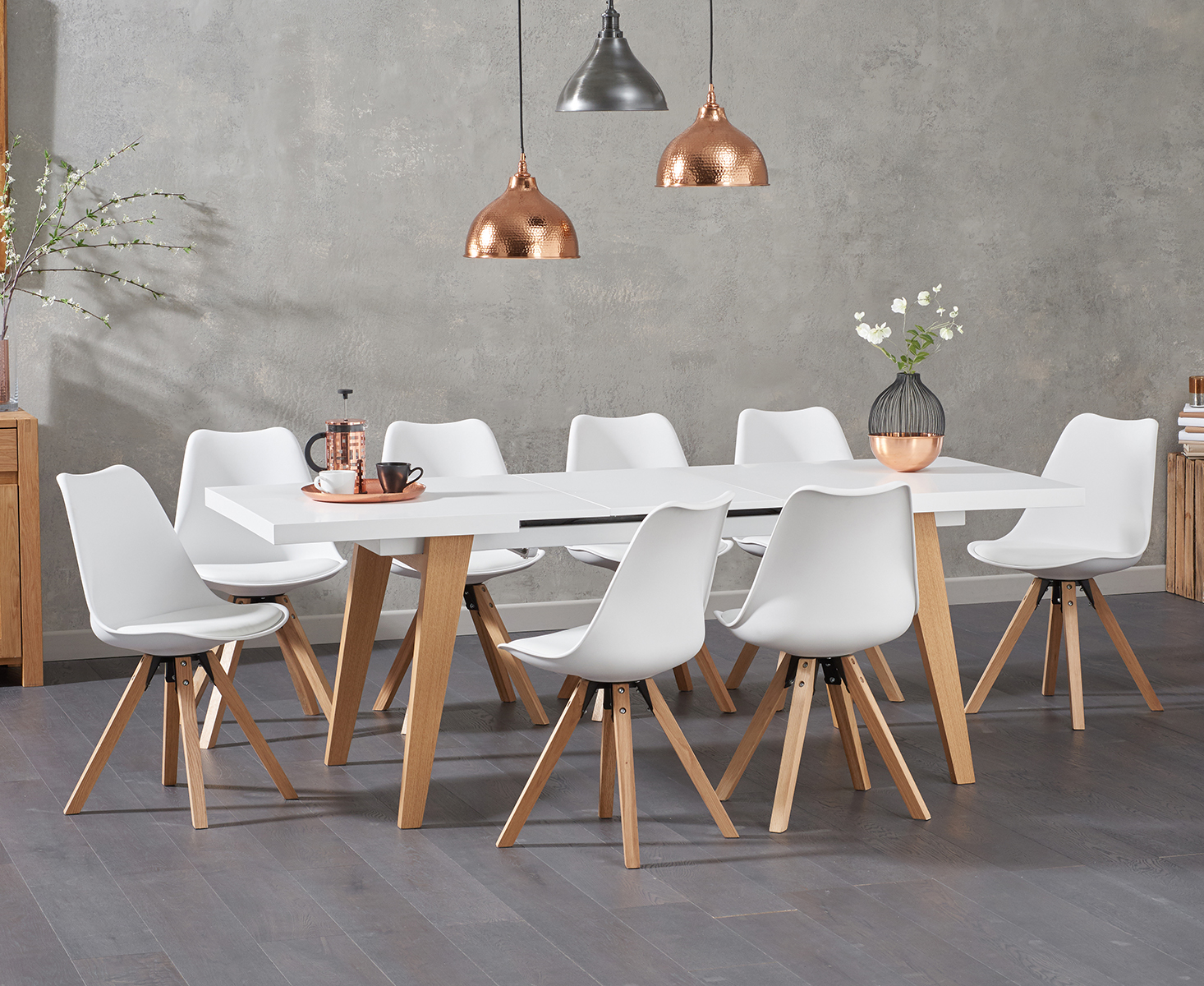 An image of Nicole Extending White Dining Table with Oscar Faux Leather Square Leg Chairs