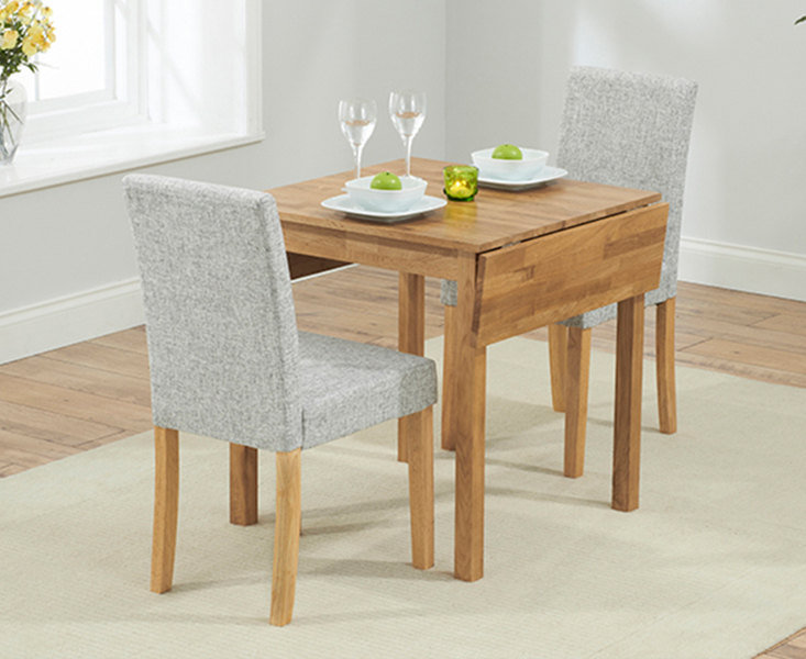 Product photograph showing Oxford 70cm Solid Oak Extending Dining Table With Mia Fabric Chairs
