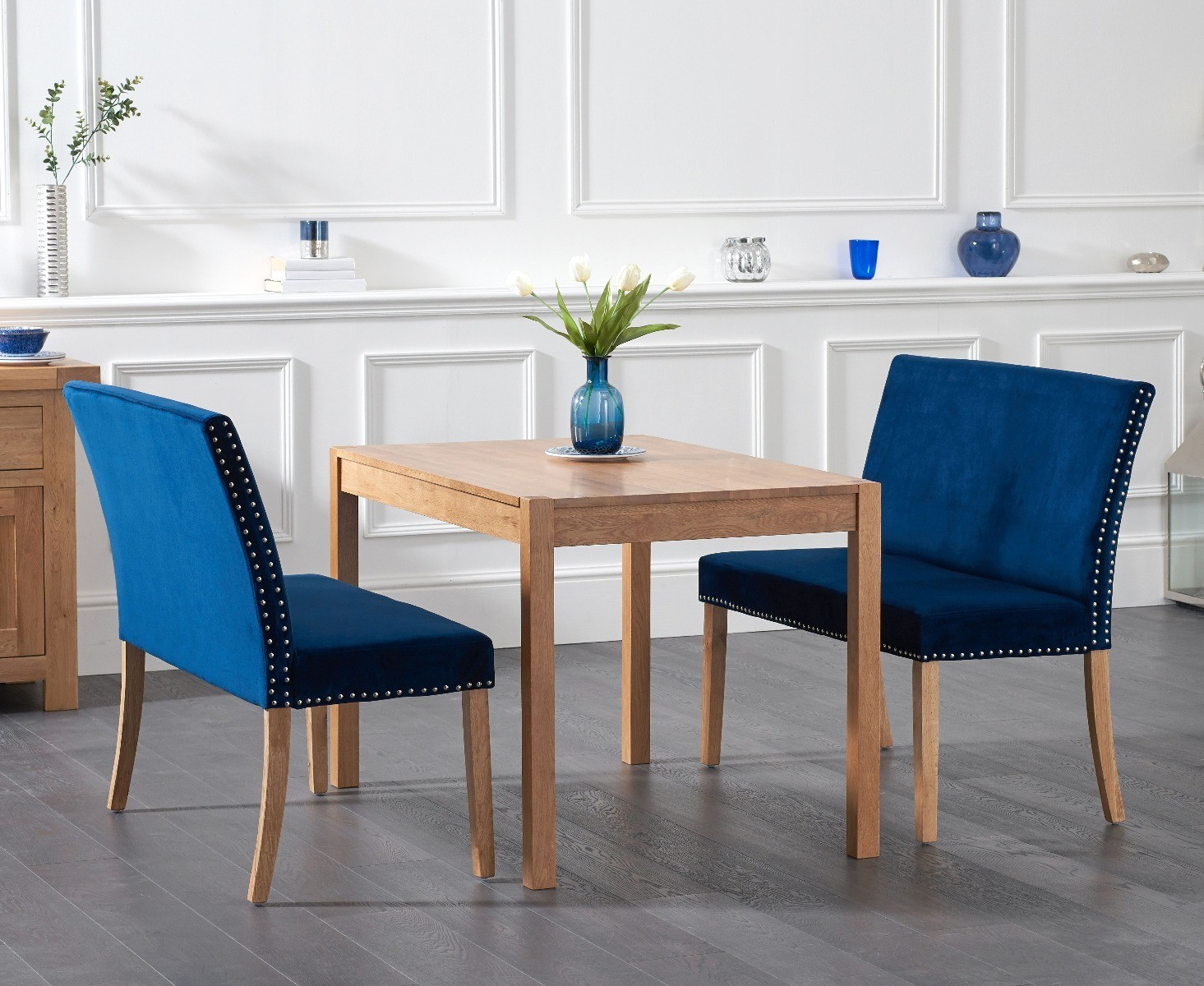 Product photograph showing Ex-display Oxford 120cm Solid Oak Dining Table With Two Mia Studded Blue Velvet Benches With Backs