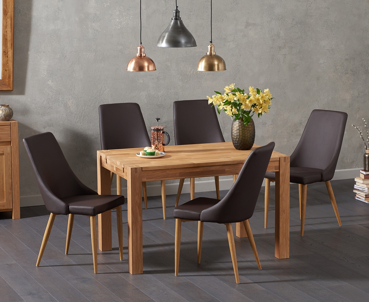 Product photograph showing Verona 120cm Solid Oak Dining Table With Ashford Faux Leather Chairs
