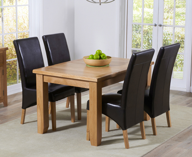 Product photograph showing Yateley 130cm Oak Extending Dining Table With Cannes Chairs