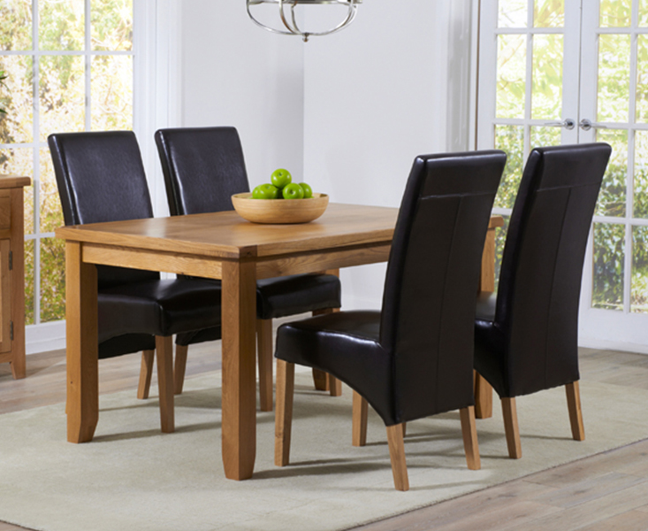 An image of Yateley 140cm Oak Dining Table with Cannes Chairs - Black, 4 Chairs
