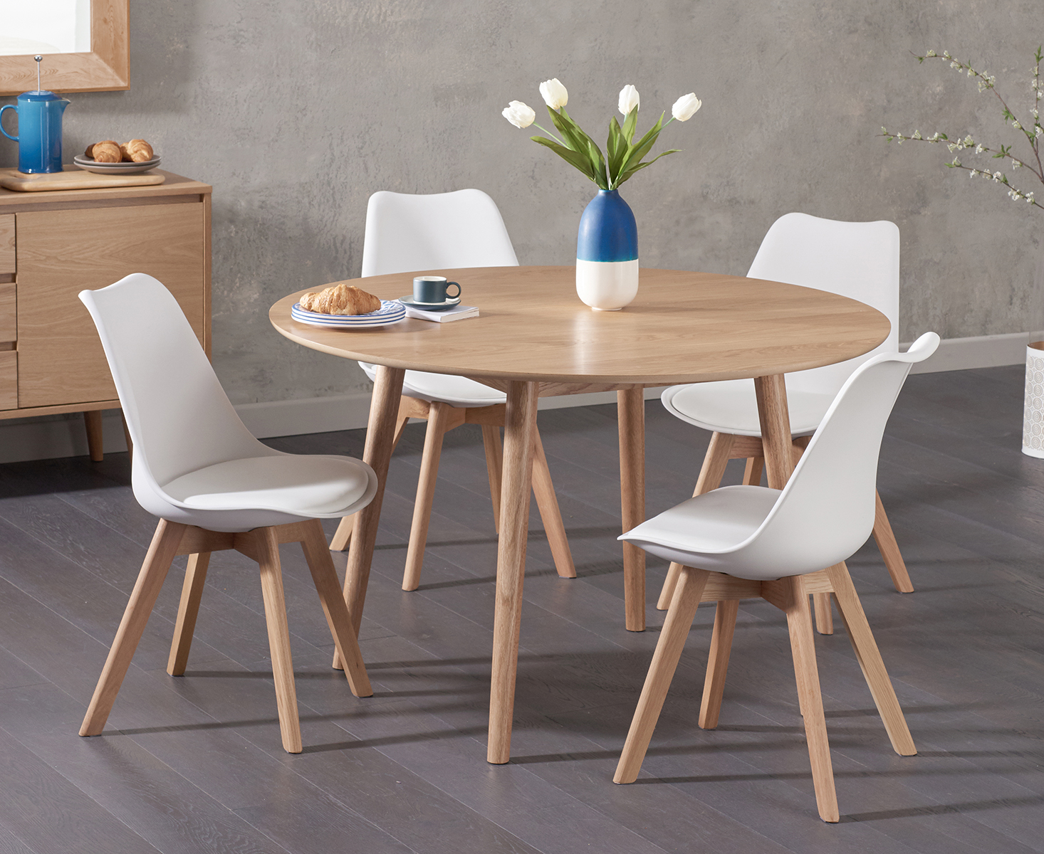 An Easy Way To Add Scandinavian Inspired Style To Your Home The Nordic 120cm Round Oak Dining Table With Duke Faux Leather Chairs Combines Good Looks With Practicality To Create A Set Thata S